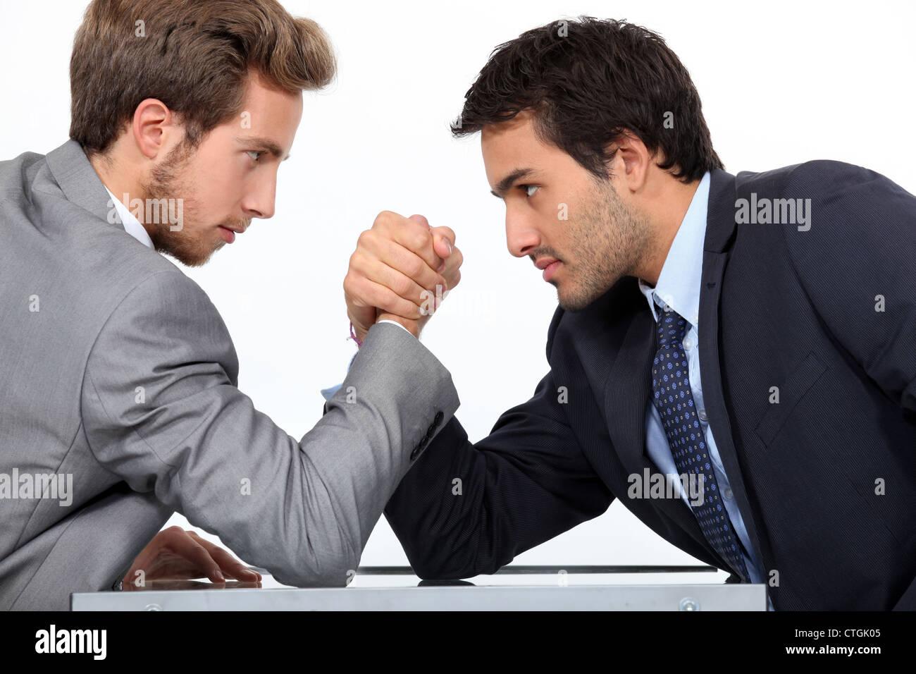 Men arm wrestling Stock Photo