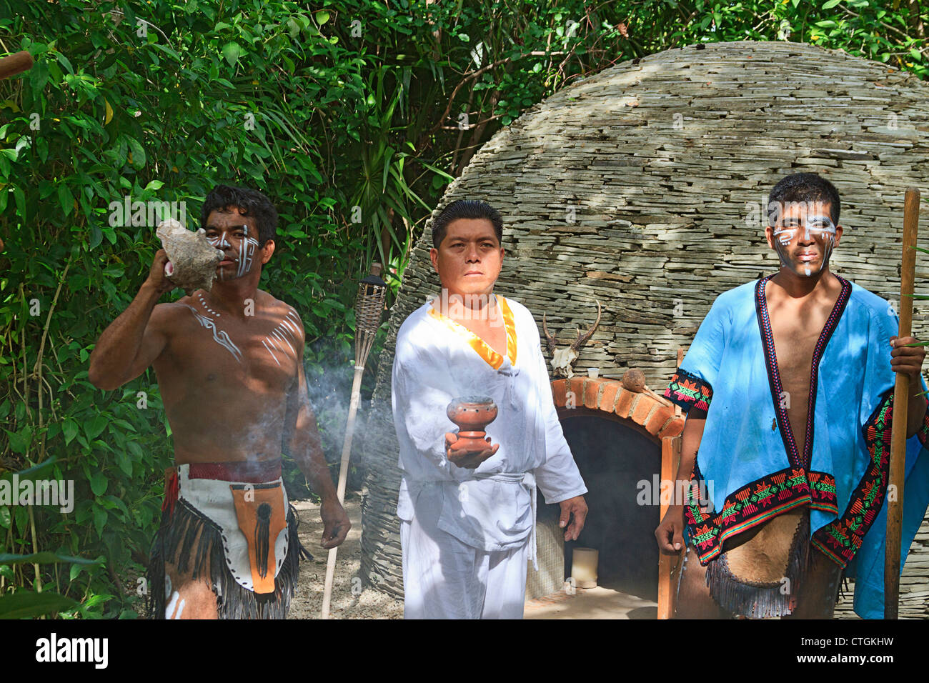 Maya Shamans greets visitors with ritual smoke from Copal resin. - Stock Image
