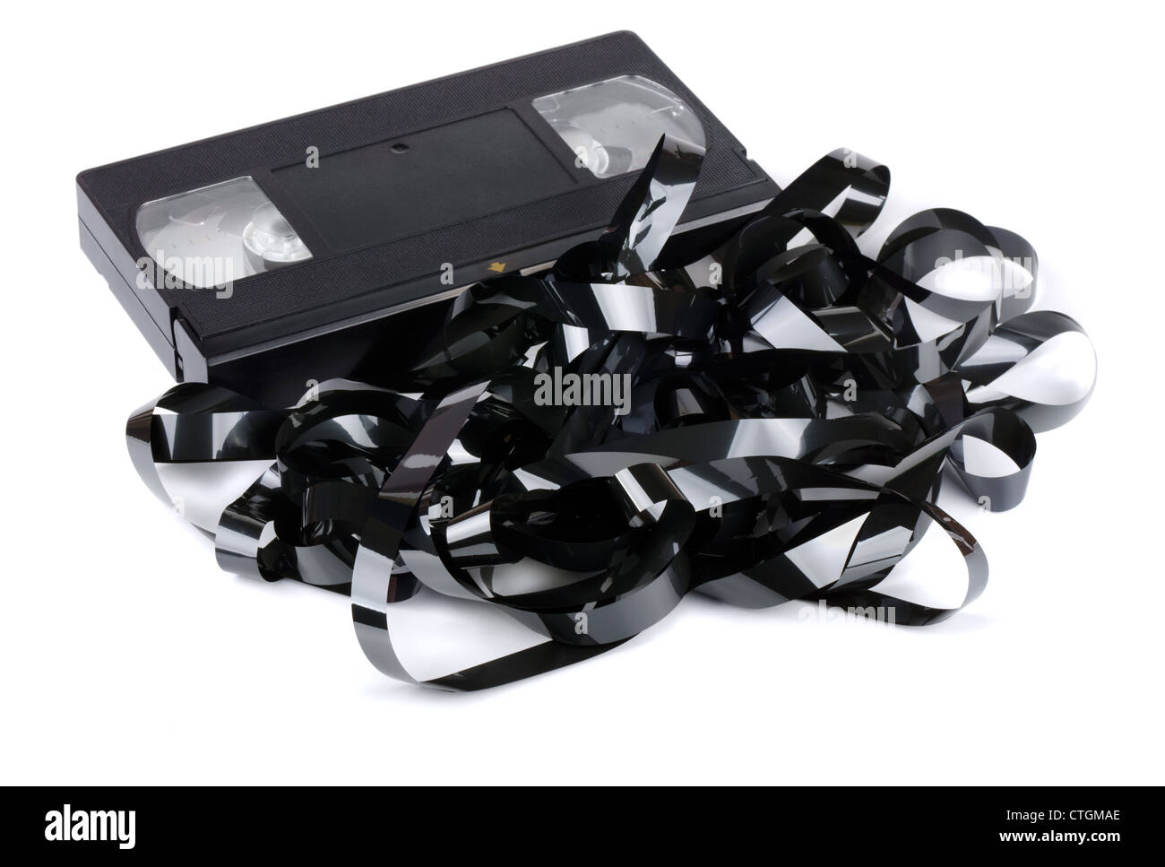 VHS video cassette with tangled video tape isolated on white - Stock Image
