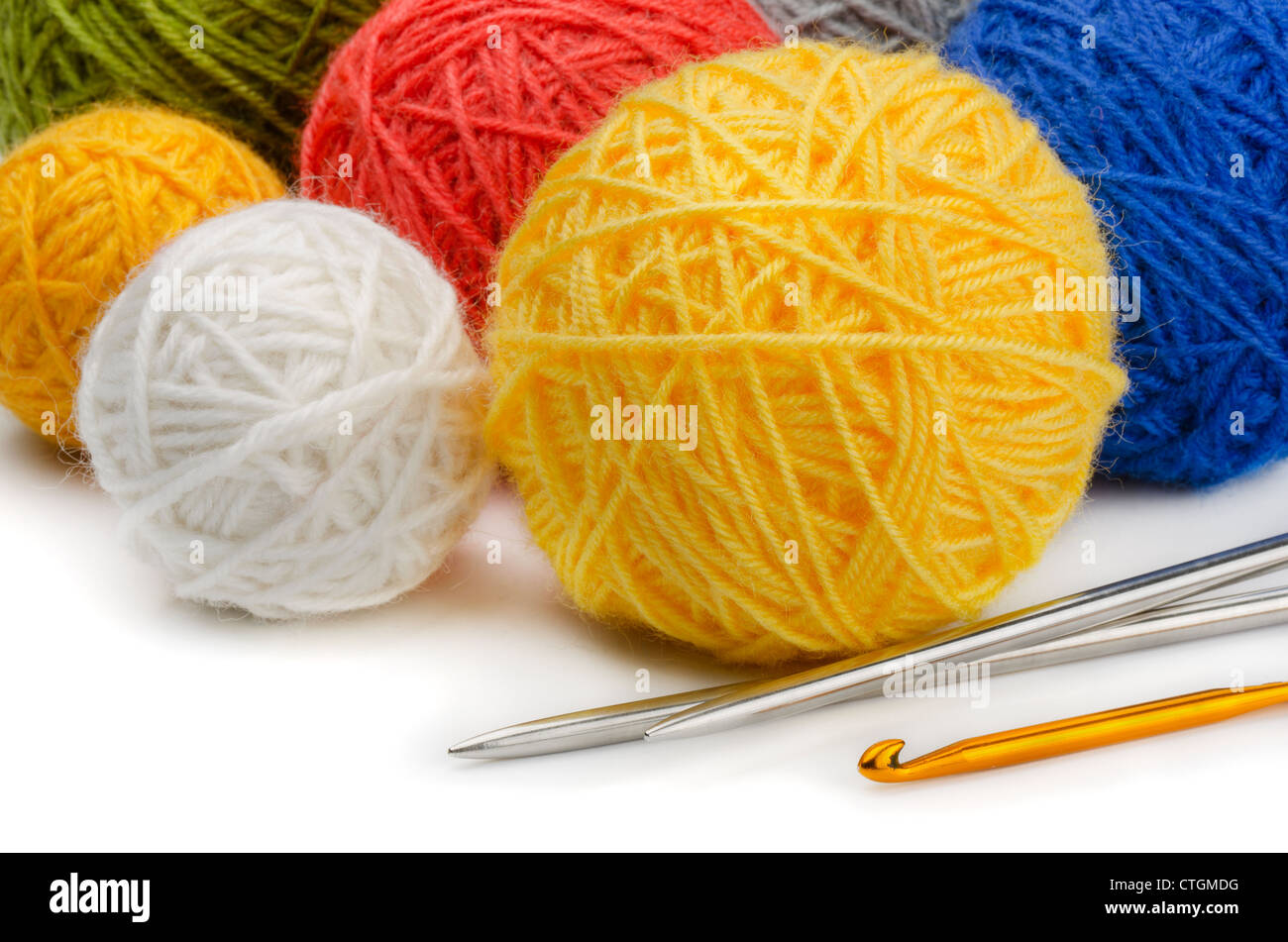 Color wool skeins, knitting needles and crochet - Stock Image