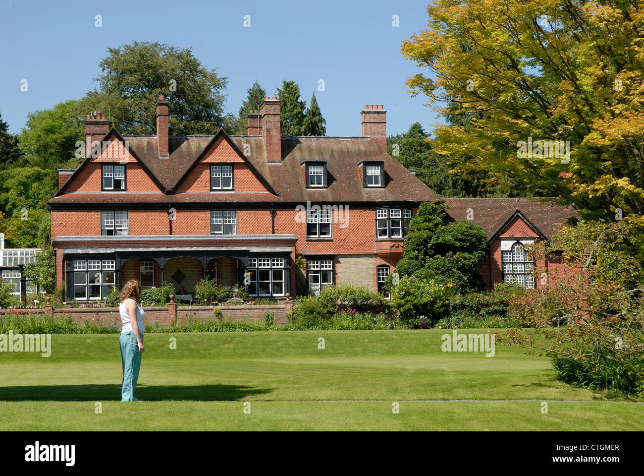 A woman enjoys the view at Hergest Croft Gardens in Kington, Herefordshire. - Stock Image
