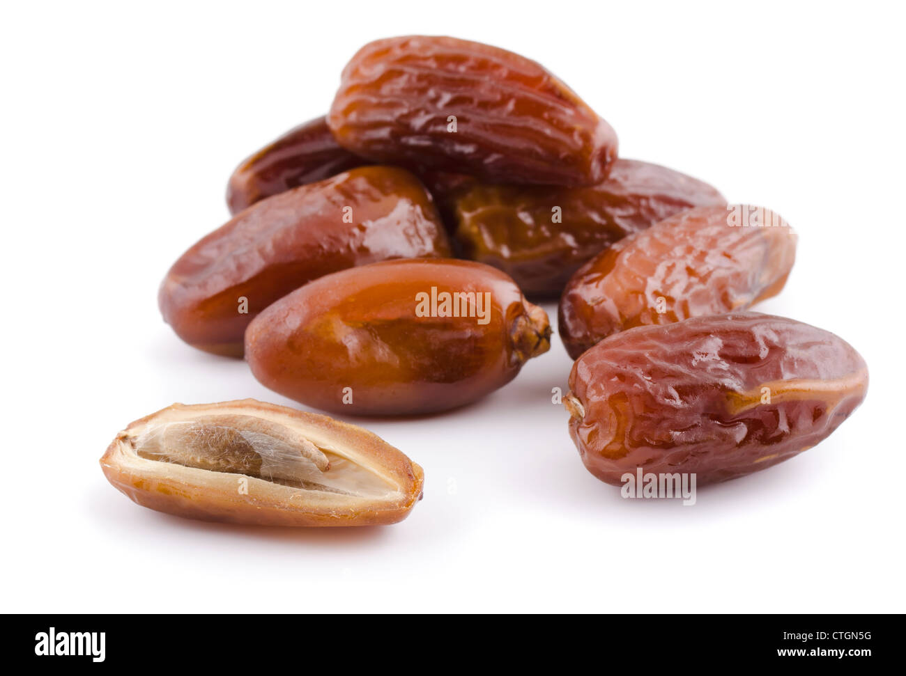Heap of dried date fruit isolated on white - Stock Image