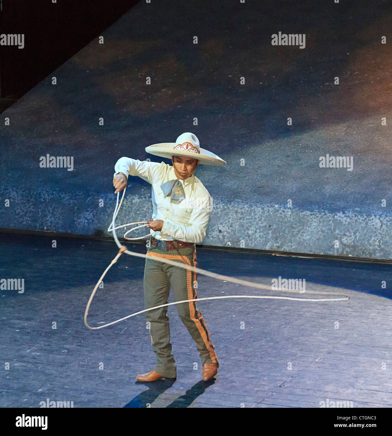 Cowboy performs with rope and lasso at Xcaret's 'Mexico Espectacular' show where 300 performers tell - Stock Image