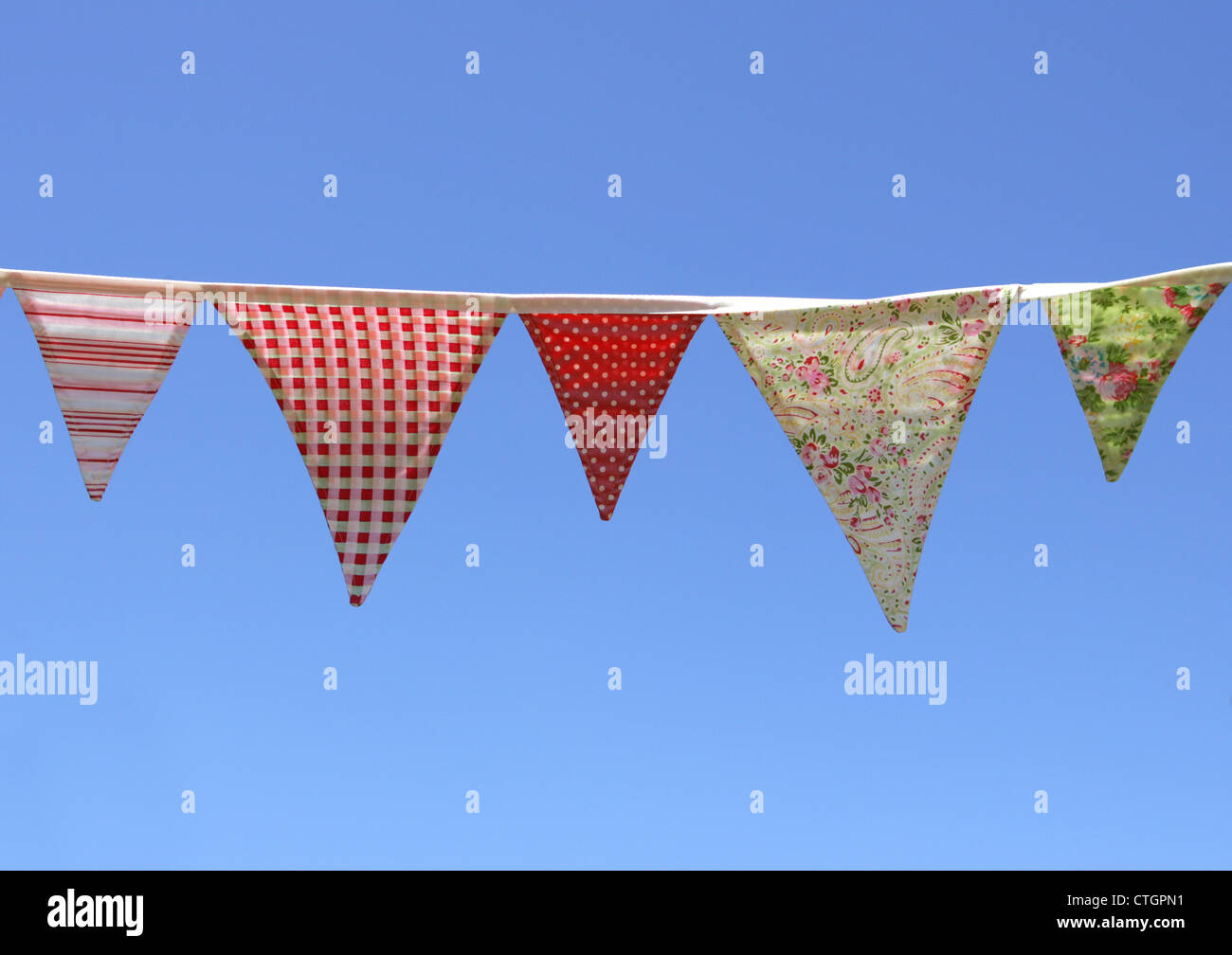 Country Bunting on blue sky - Stock Image