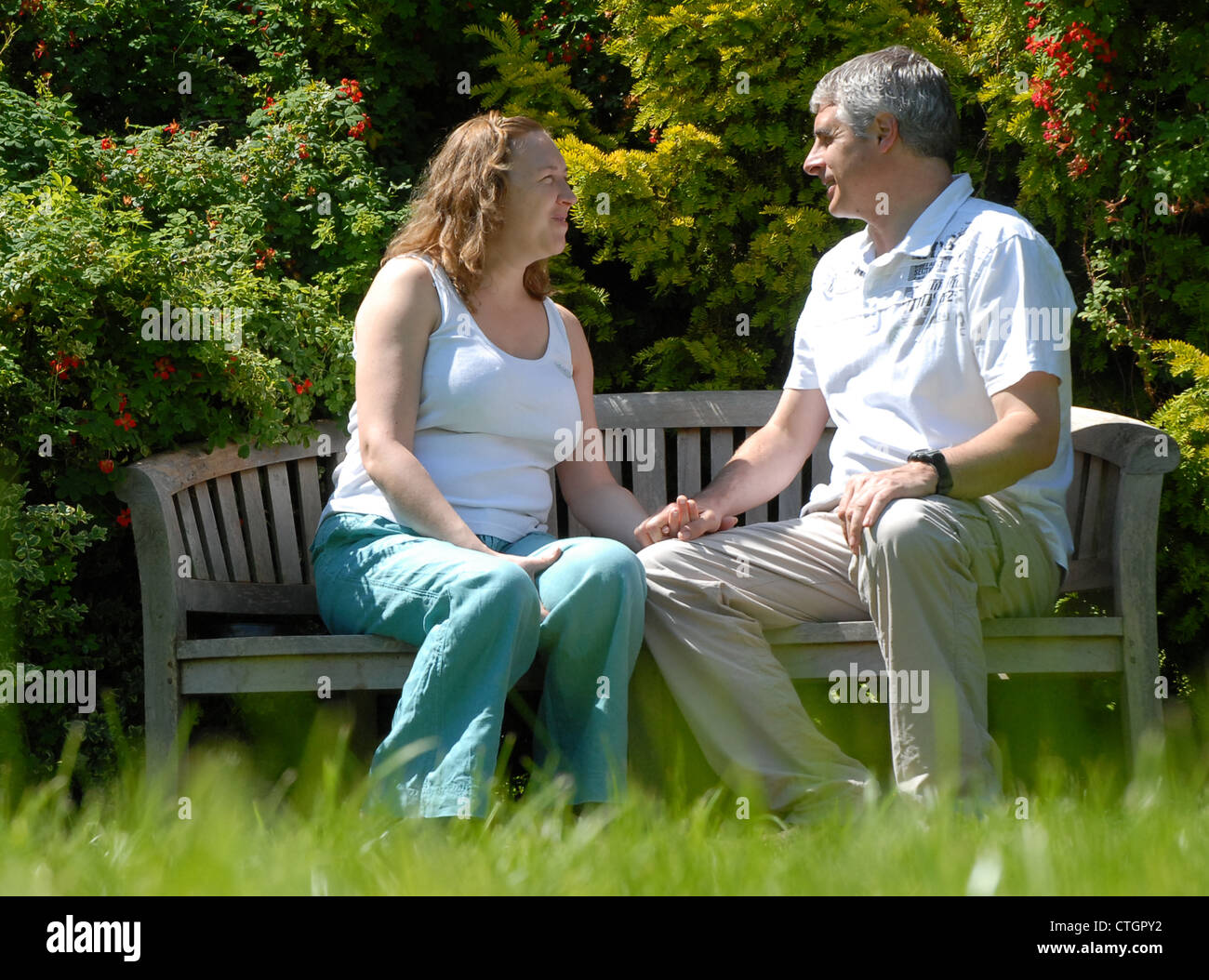 A couple hold hands at on a day out at Hergest Croft Gardens, Kington, Herefordshire. - Stock Image