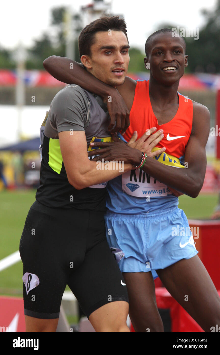 Adam KSZCZOT (Poland) celebrates with Job KINYOR (Kenya) after winning the mens 800 metres at the AVIVA 2012 London - Stock Image