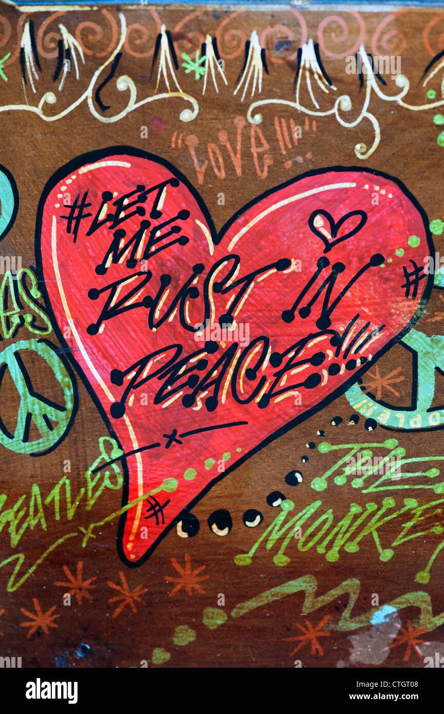 Hippie VW Volkswagen camper van painted wooden door abstract. Let me rust in peace painting Stock Photo