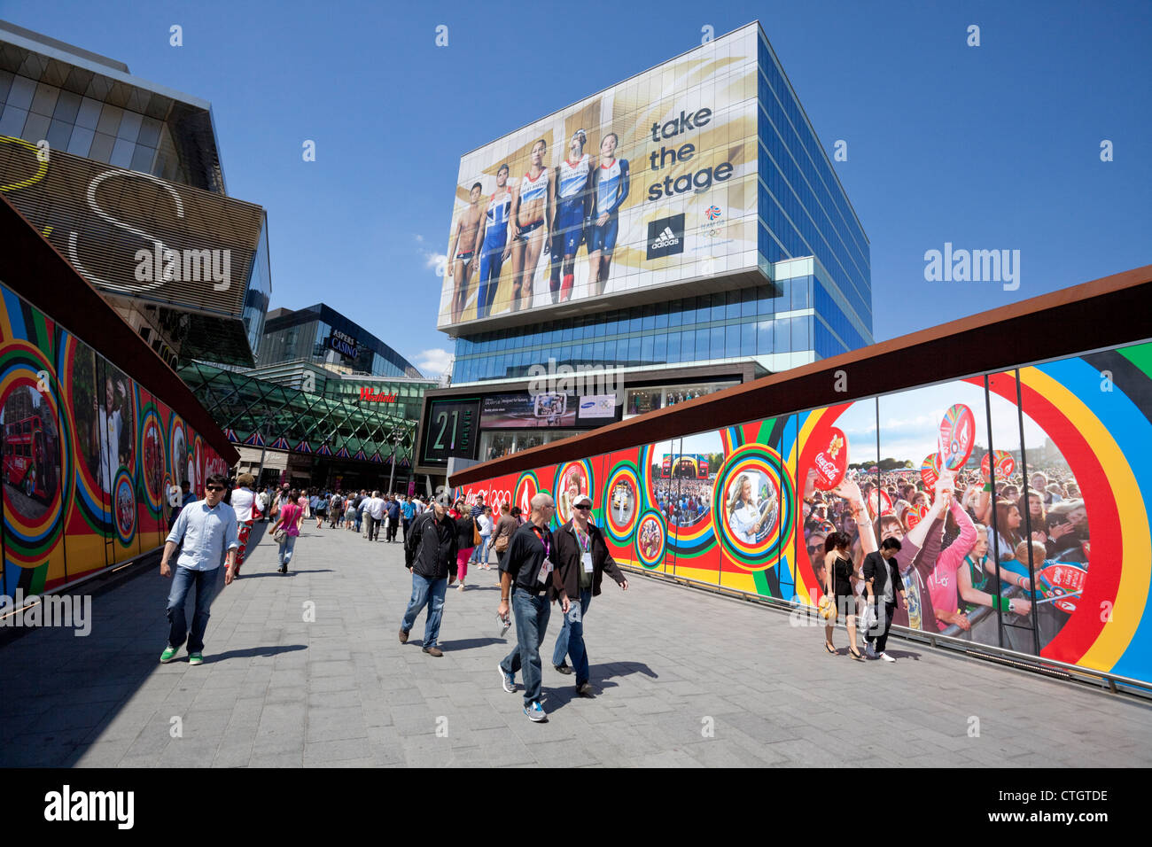 Westfield Stratford City Shopping Centre and footbridge, displaying colourful Olympic Games advertisement, Stratford, - Stock Image