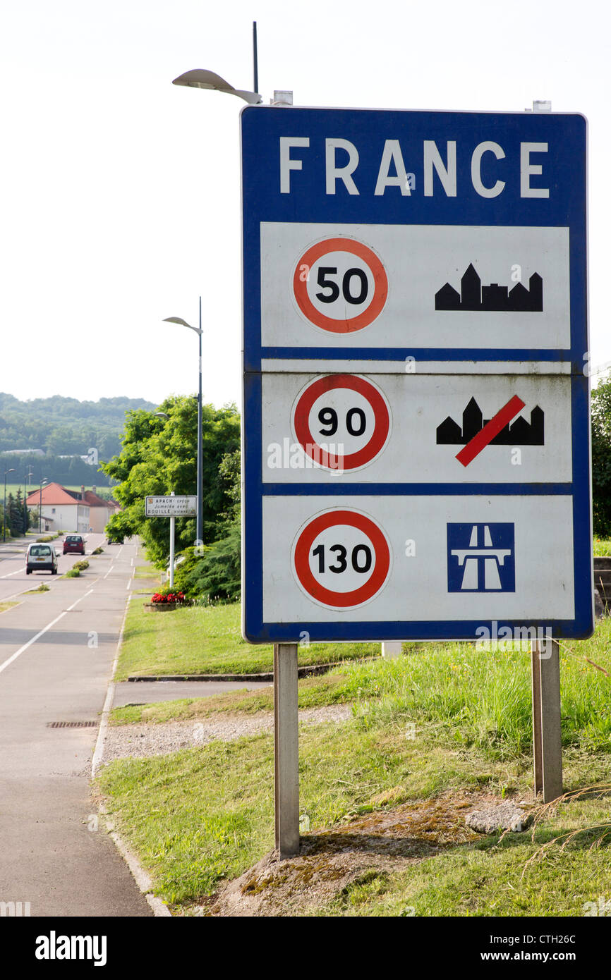 Border sign with speed limits on french roads in Apach near the german and luxembourg border. - Stock Image