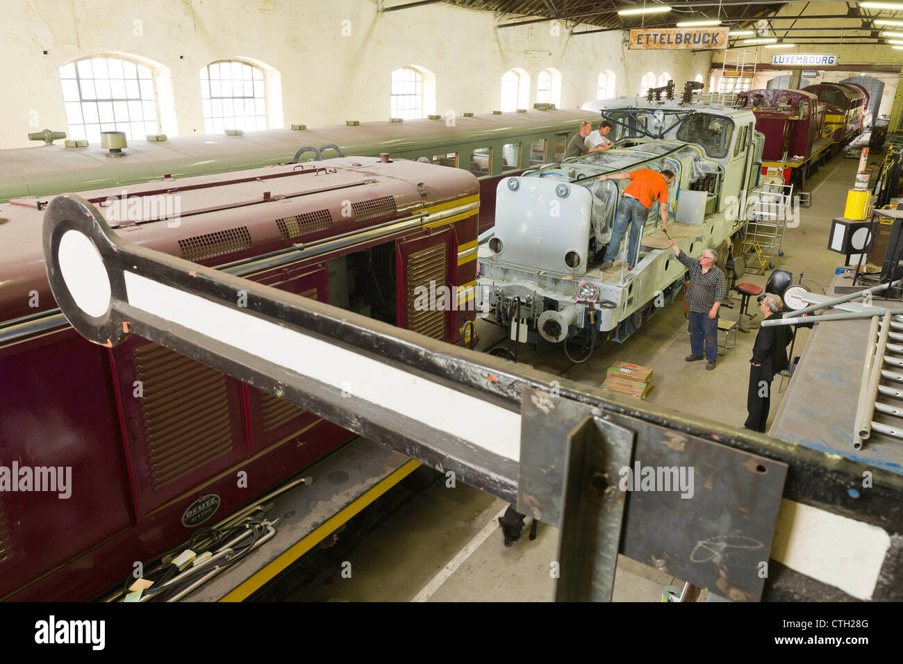 Railway Repair Shop of the 1604 Classics club.Diesel locomotive 450 and a BB3608 getting readied for painting. - Stock Image