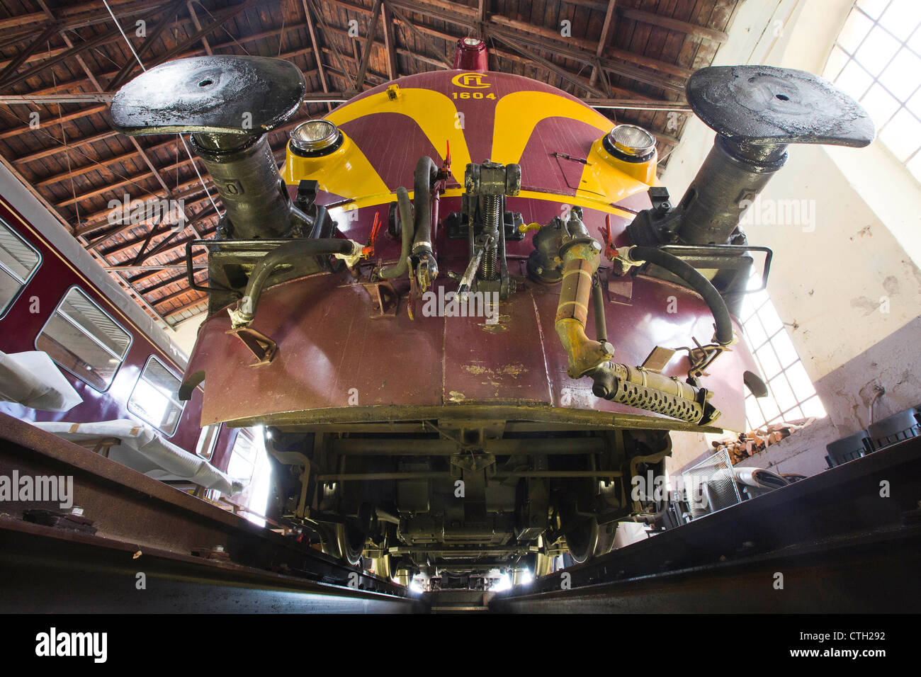 Railway Repair Shop of the 1604 Classics club.  View from below of a Diesel Locomotive 1604. - Stock Image