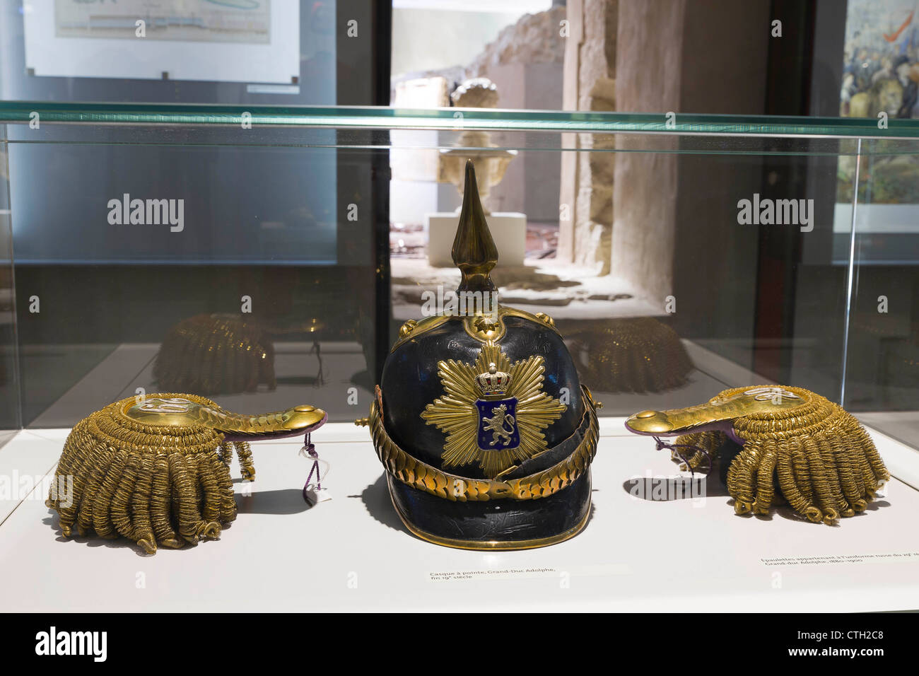 German spiked helmet and epaulettes from Grand Duke Adolphe times. - Stock Image