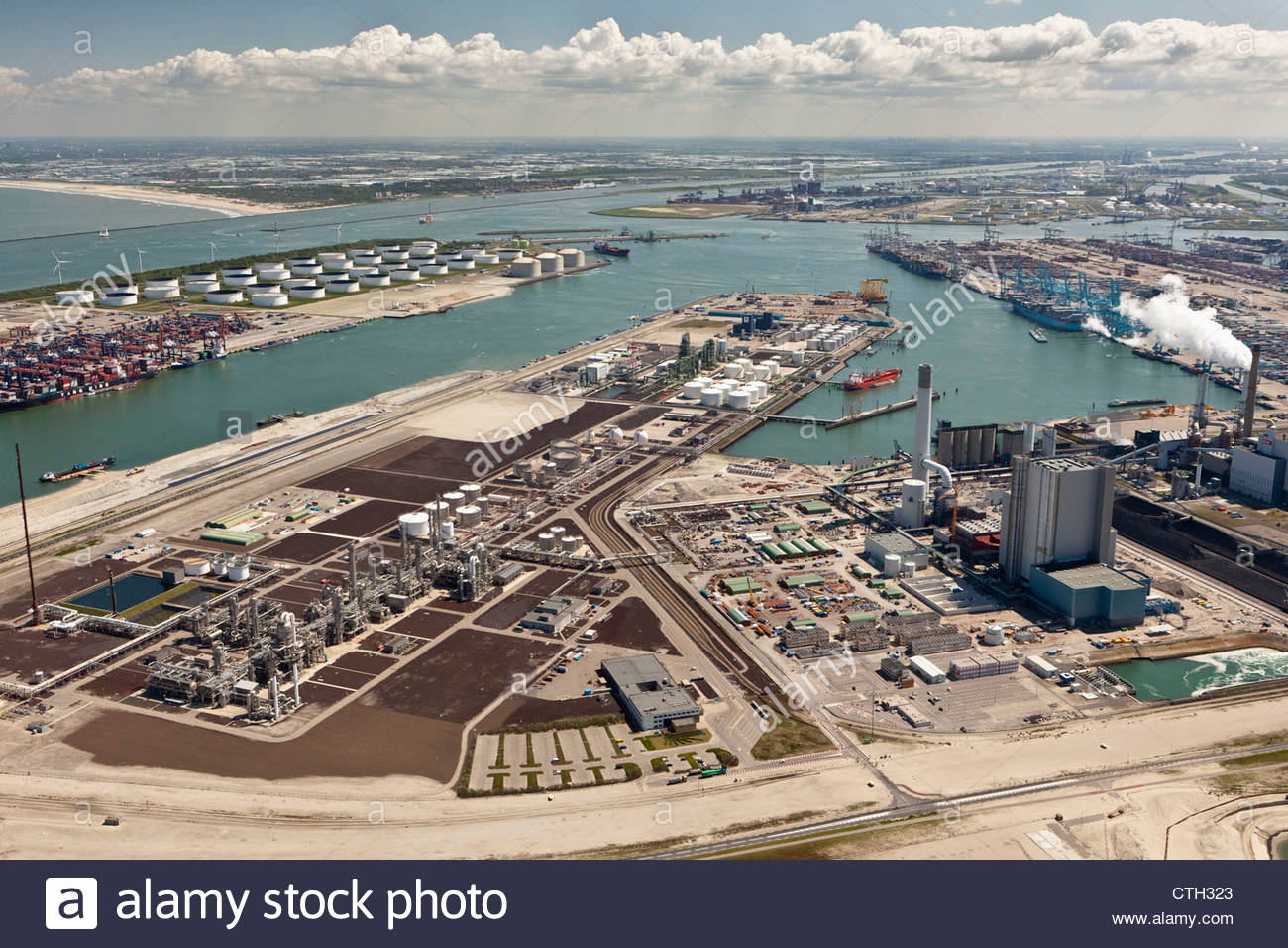 The Netherlands, Rotterdam, Port. Container and oil storage. Aerial. - Stock Image