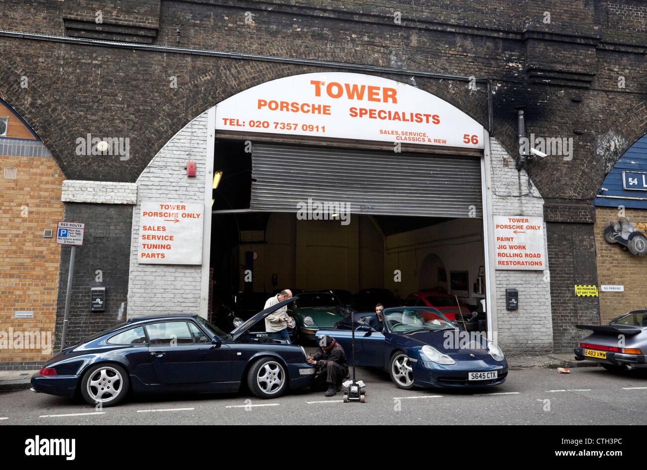 Mechanics working on Porches at a Porsche specialist garage, Druid