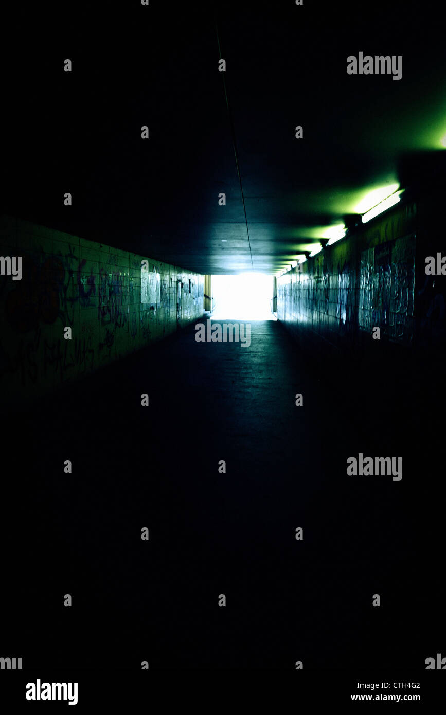 dark underpass with light at the end of it, afterlife concept - Stock Image