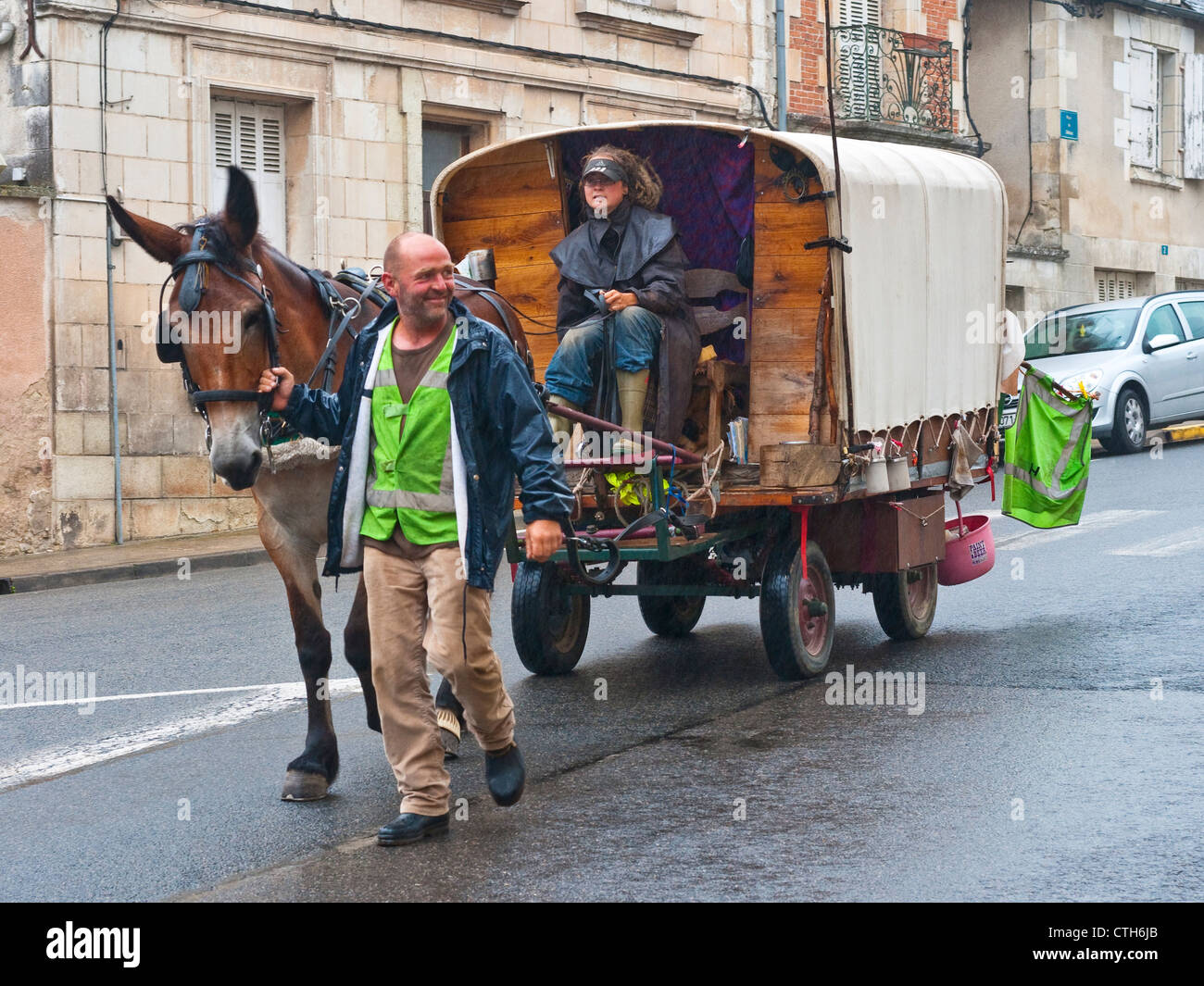 Horse-drawn wooden caravan and travelers - France. - Stock Image