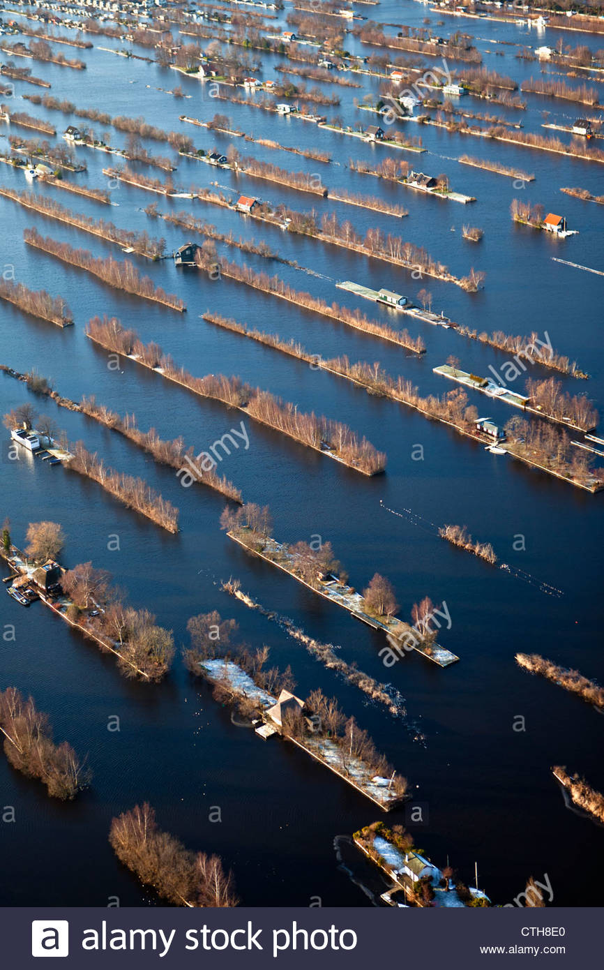 Now serving aquatic sports. The remaining small islands are housing holiday houses. Aerial. Winter. Frost. - Stock Image