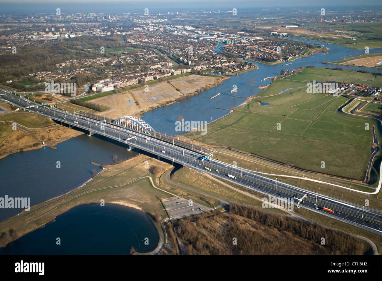 The Netherlands, Vianen, Bridge over highway A2. Aerial Stock Photo