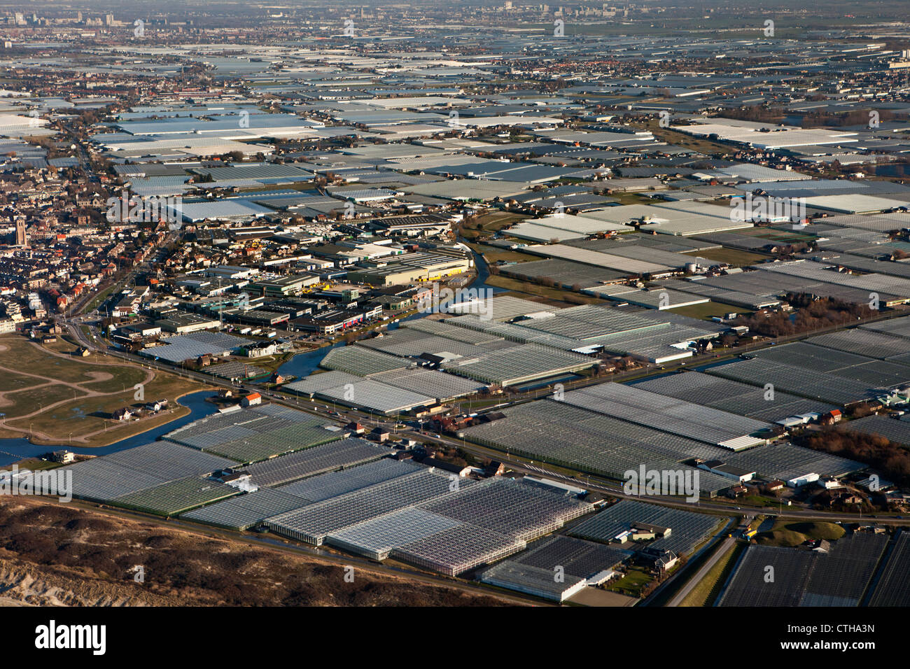 The Netherlands, Monster, Westland region. Horticulture in greenhouses. Aerial. - Stock Image