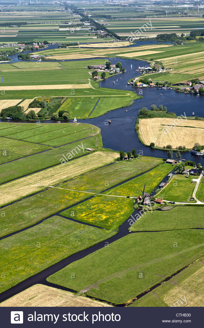 The Netherlands, Warmond, Yachts in lakes called Kagerplassen. Aerial. Windmill. - Stock Image