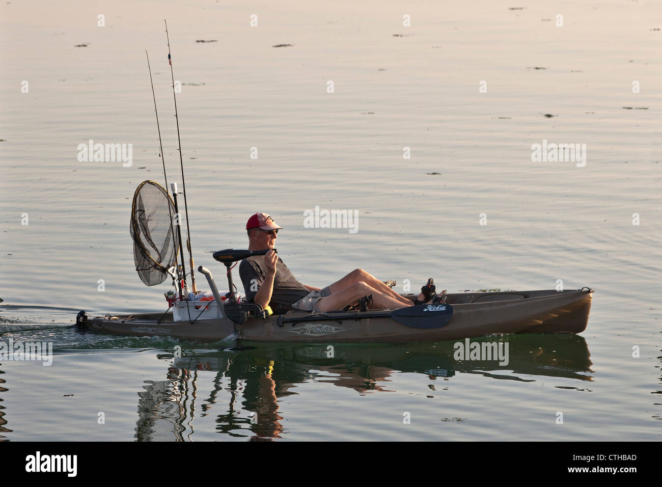 The Netherlands, Zierikzee, Fisherman in cycle-kayak with