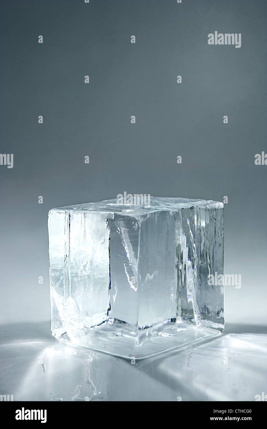 transparent big ice cube on neutral background - Stock Image