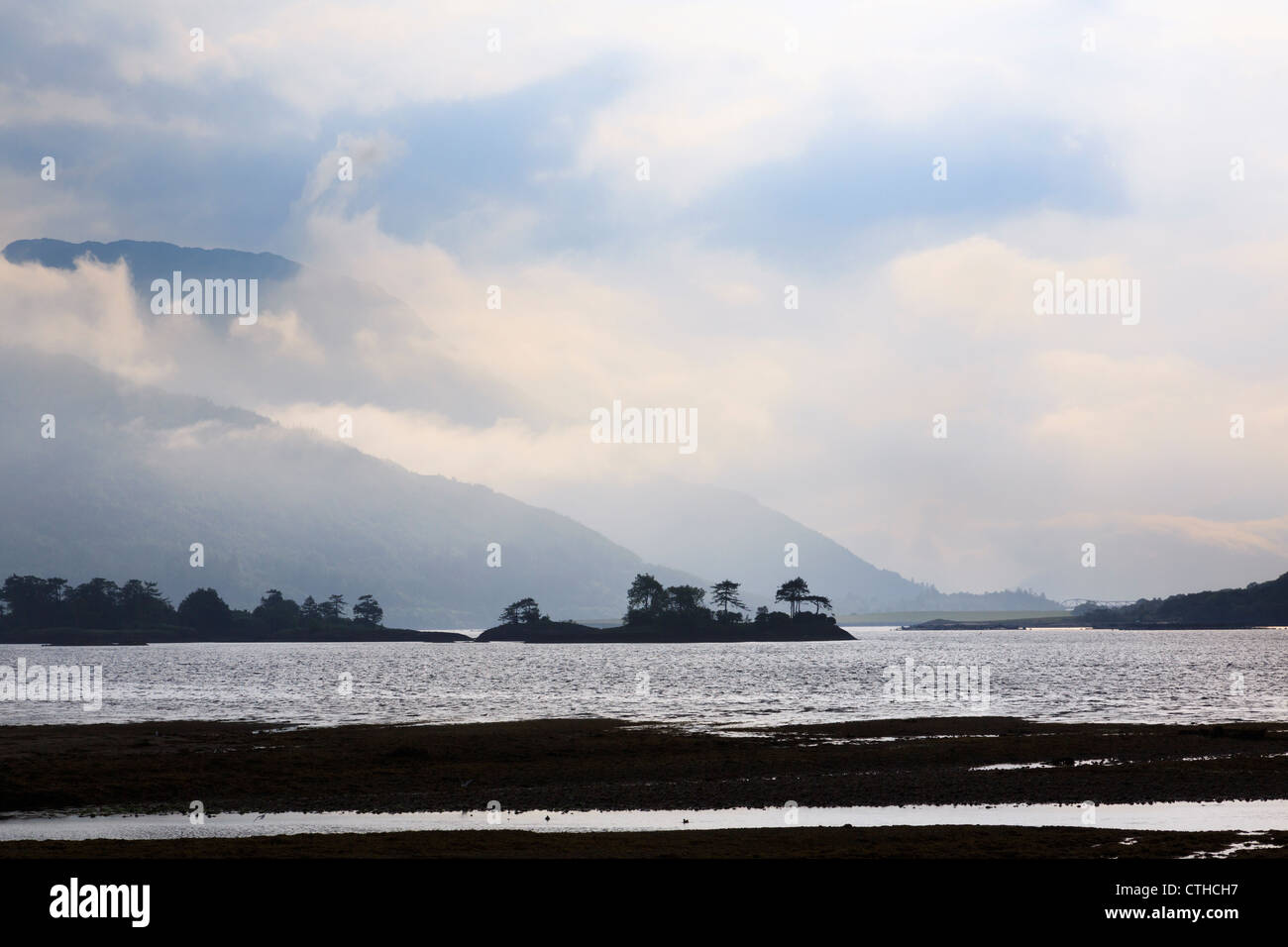 Improving weather scene with low cloud breaking up over Loch Leven and mountains in evening from Glencoe Highland - Stock Image