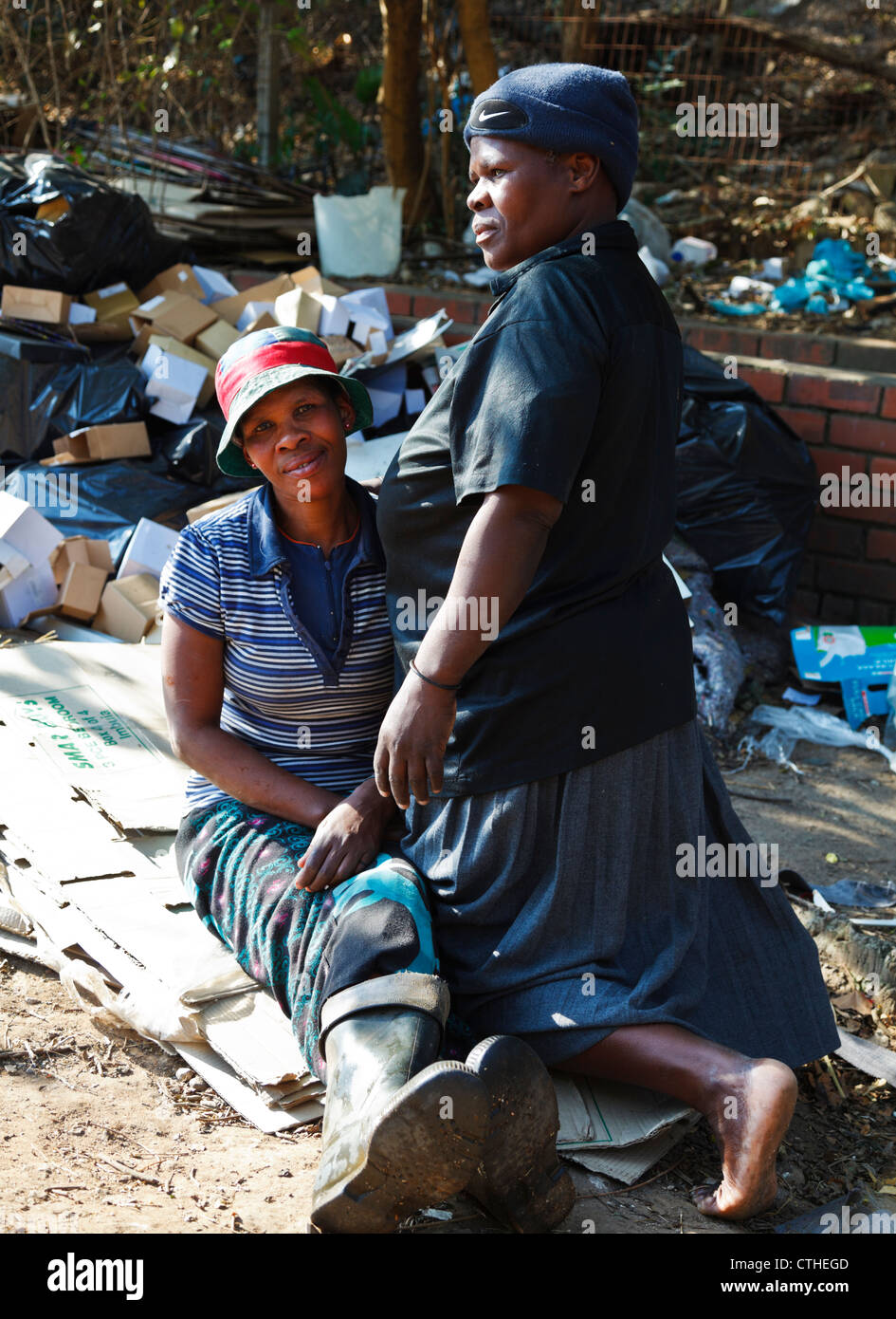 The plight of the poor in Africa as these African woman are forced to live and work in the streets of a city in - Stock Image