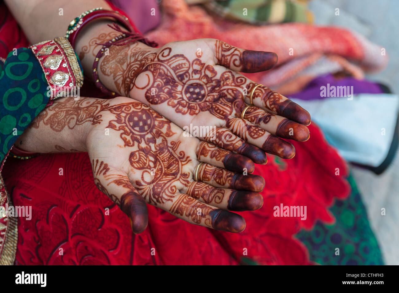An Indian woman with henna tattoos on the hands, India - Stock Image