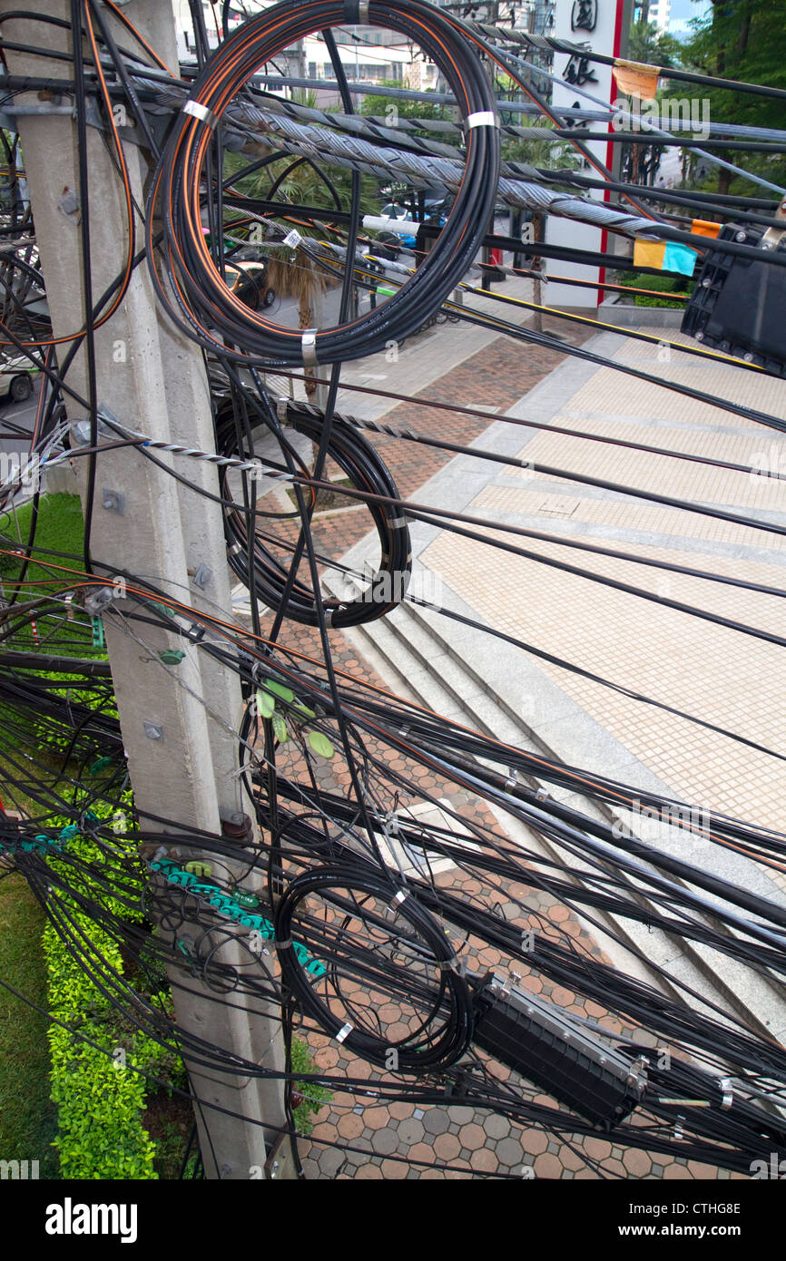 Utility pole with assorted cables and wires in Bangkok, Thailand. - Stock Image
