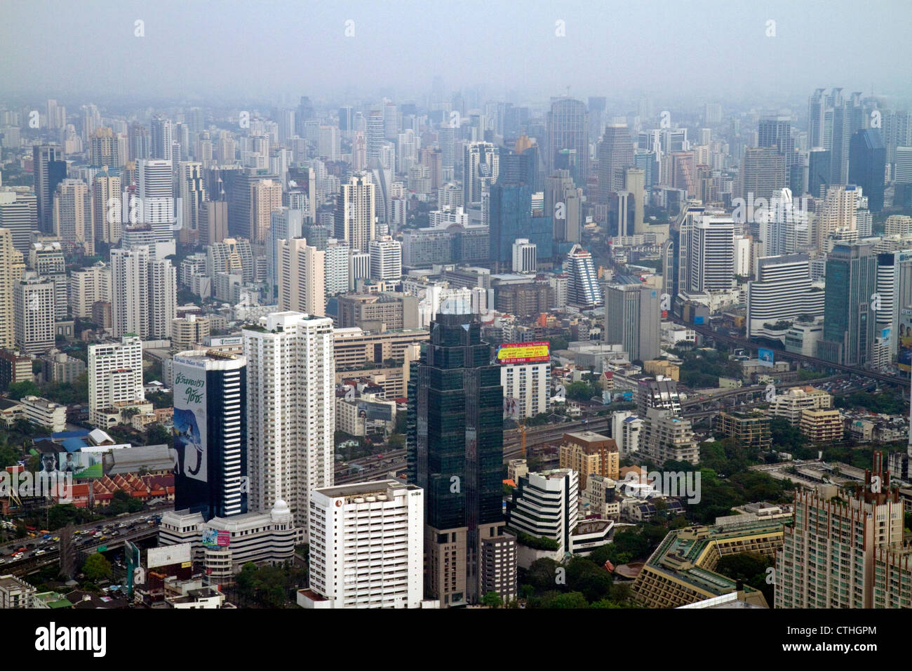 View of the Bangkok cityscape taken from the Baiyoke Tower II showing air pollution and smog, Thailand. - Stock Image