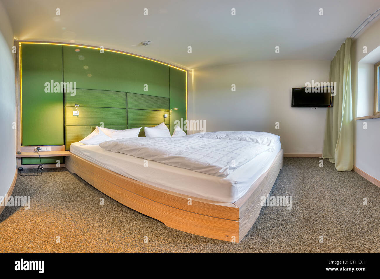 Contemporary bedroom in the Kaufmann hotel, Bavaria - Stock Image