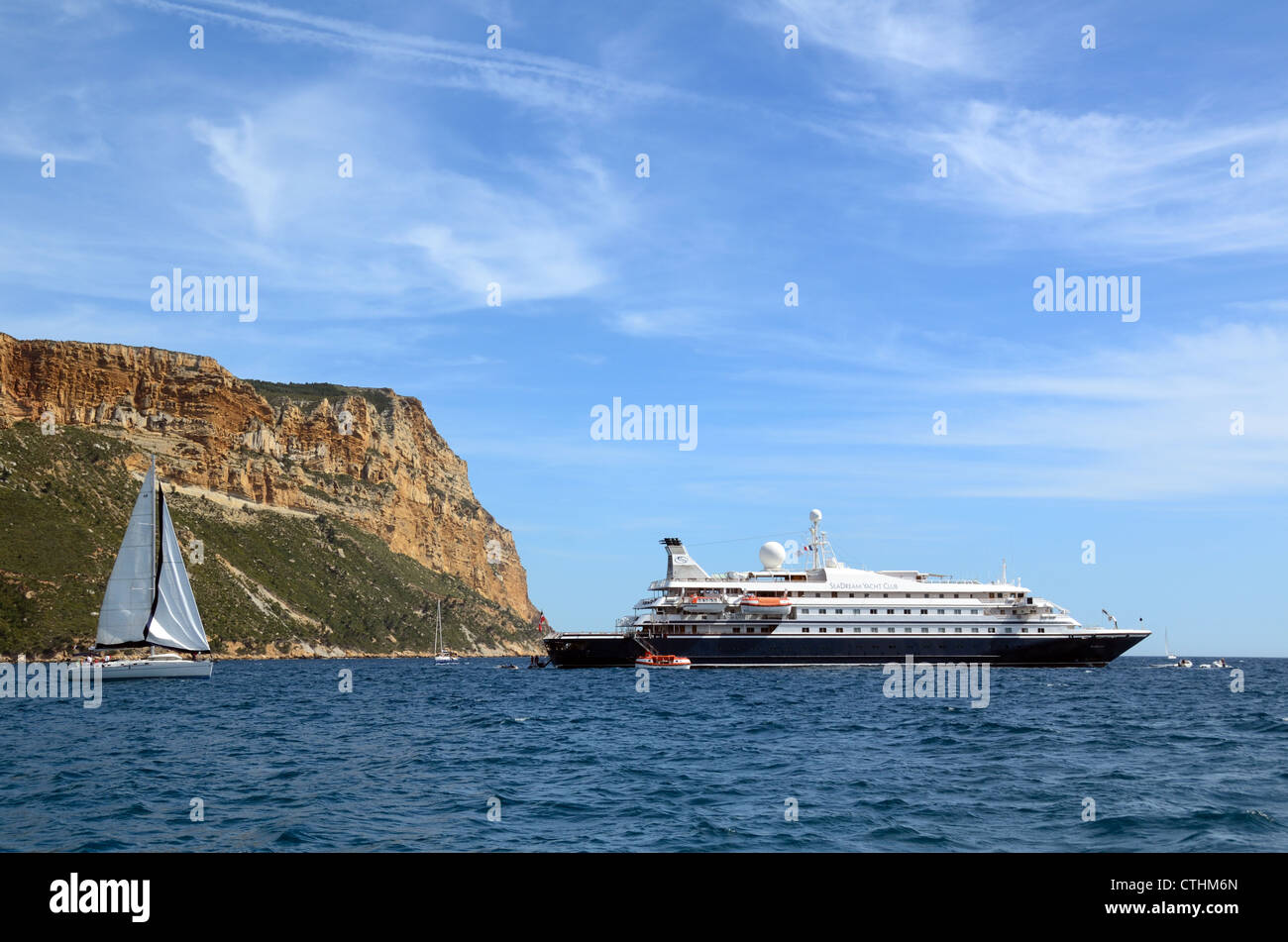 Mediterranean Cruise Ship Anchored off Cap Canaille Cliffs in the Bay of Cassis Provence France - Stock Image