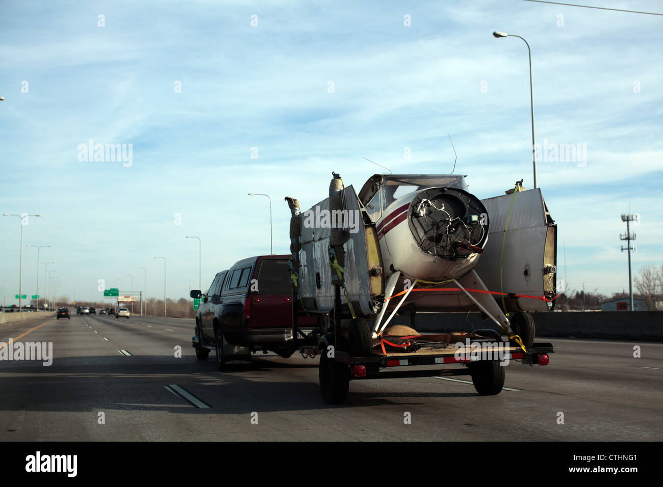 A small plane being transported on a flatbed trailer, disassembled. - Stock Image