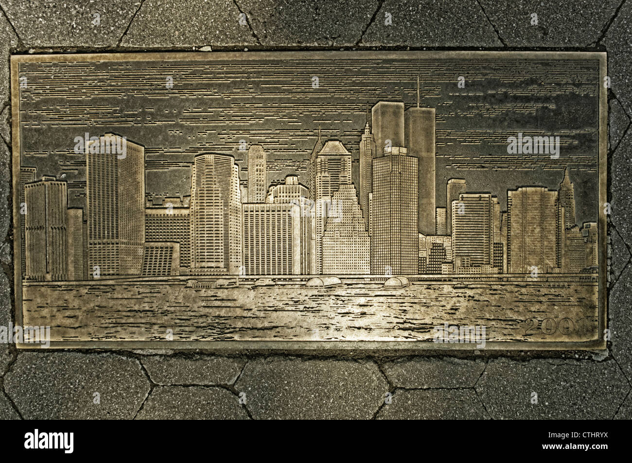 Lower Manhattan Skyline before 911 in metal plate at Brooklyn Heights Promenade - Stock Image