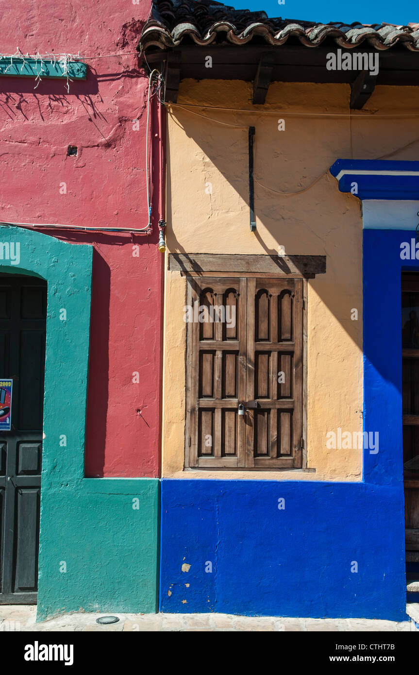 Colorful Mexican houses against blue sky Stock Photo