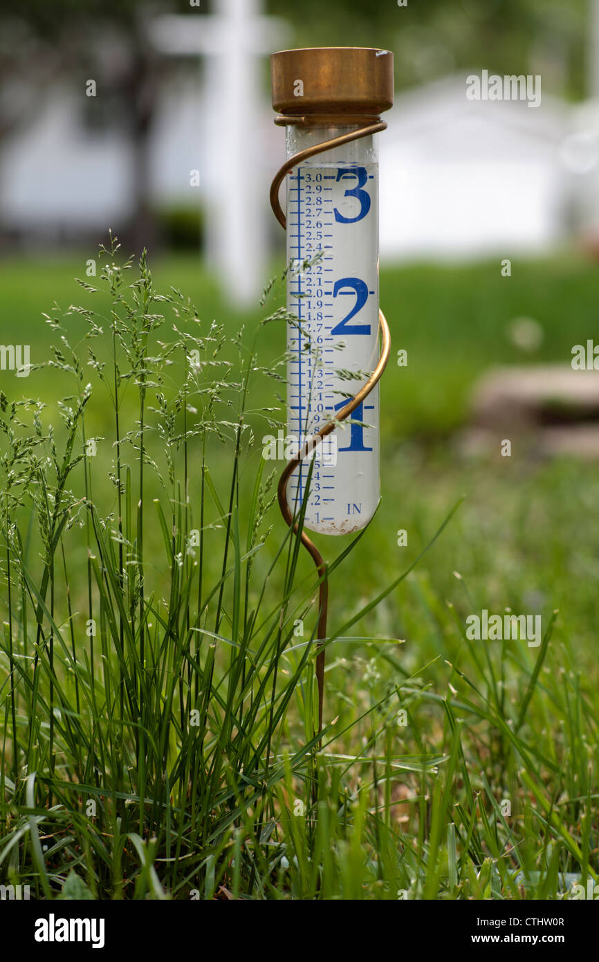 Rain gauge showing more than 3 inches of water. - Stock Image