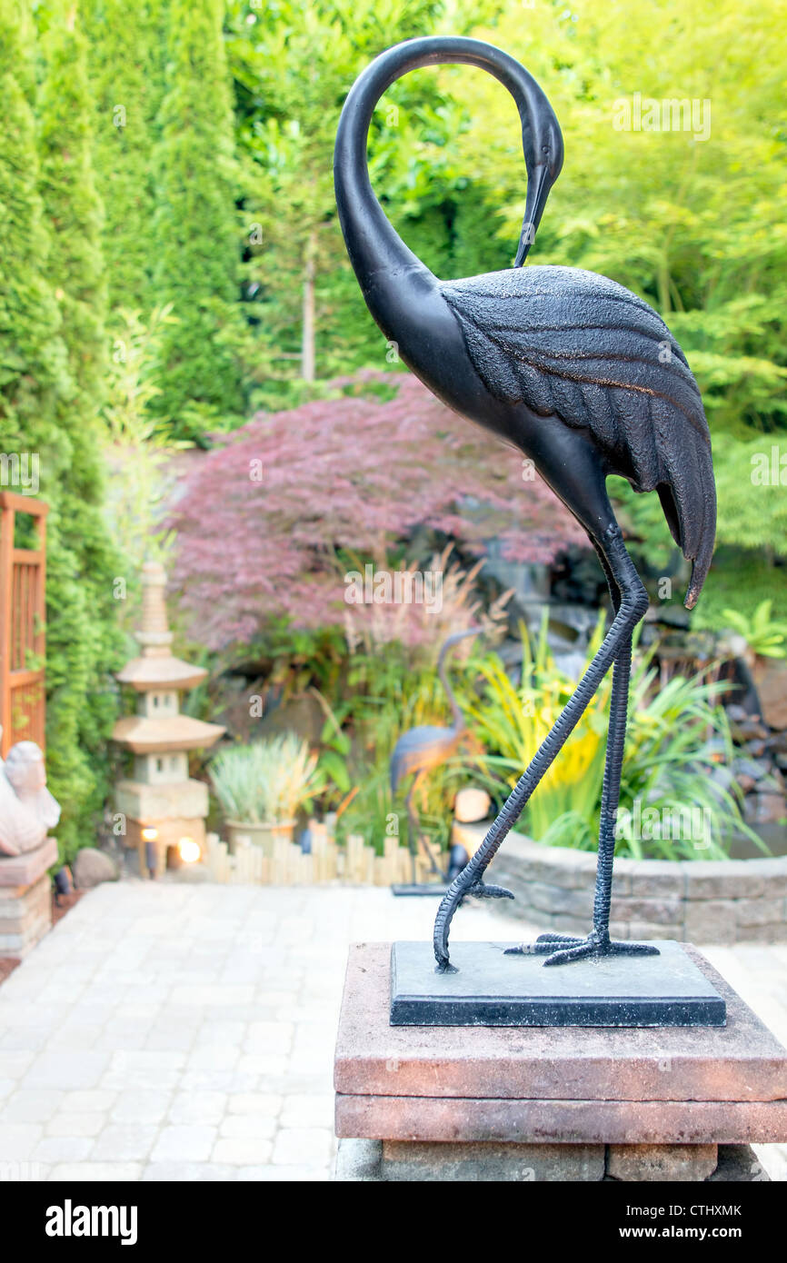 Bronze Crane Statue In Asian Japanese Inspired Garden With Pagoda Pond And  Paver Patio