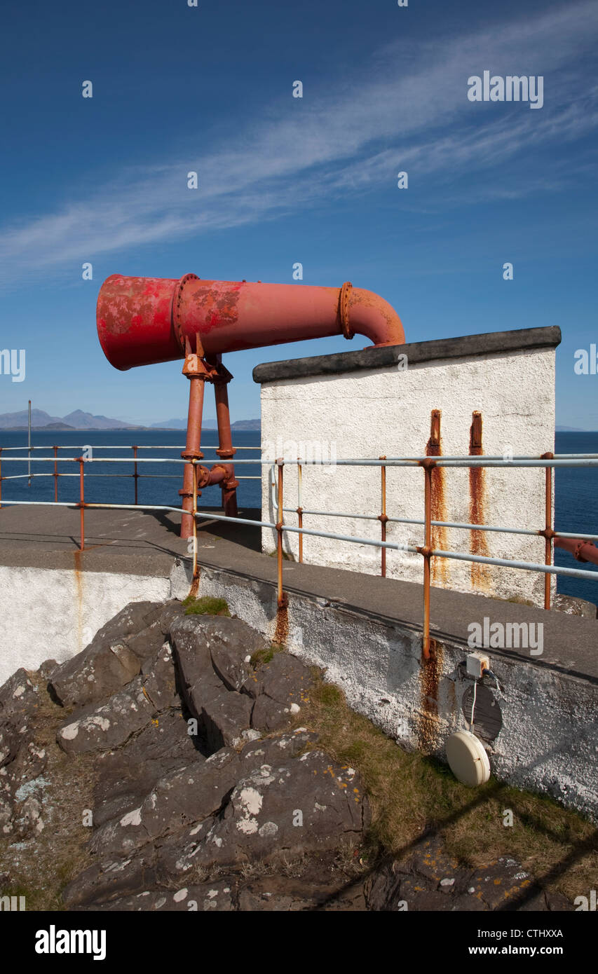 The foghorn at Ardnamurchan lighthouse on the west coast of Scotland with Rum island over the sea in the distance - Stock Image