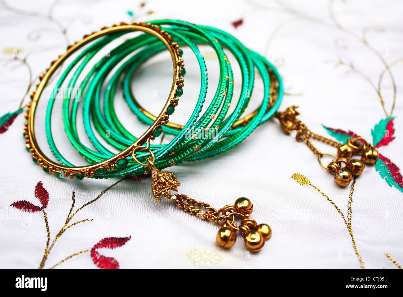 Indian green ornamental bangles - Stock Image