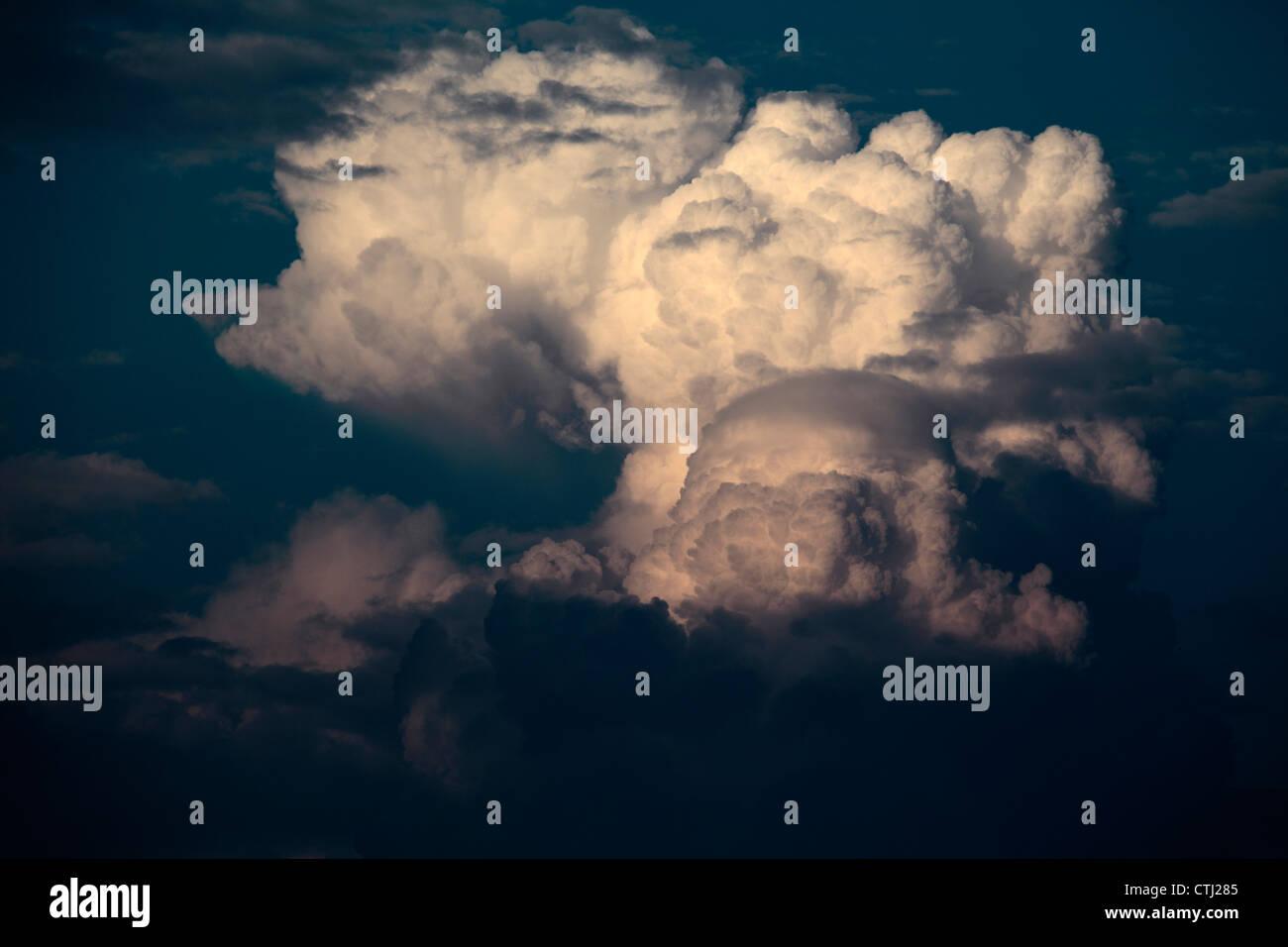Cumulonimbus cloud at sunset. - Stock Image