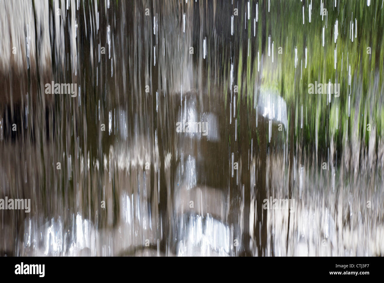 Translucent Curtain of water from a waterfall - Stock Image