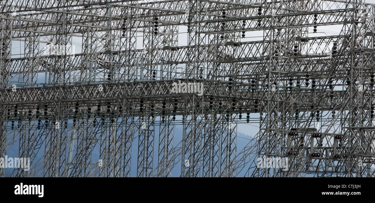 Complex steel structure of electrical power grid that takes up full frame - Stock Image