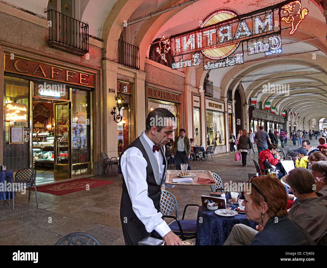 People in front of Cafe Torino , Piazza Castello , Piemont, Italy - Stock Image