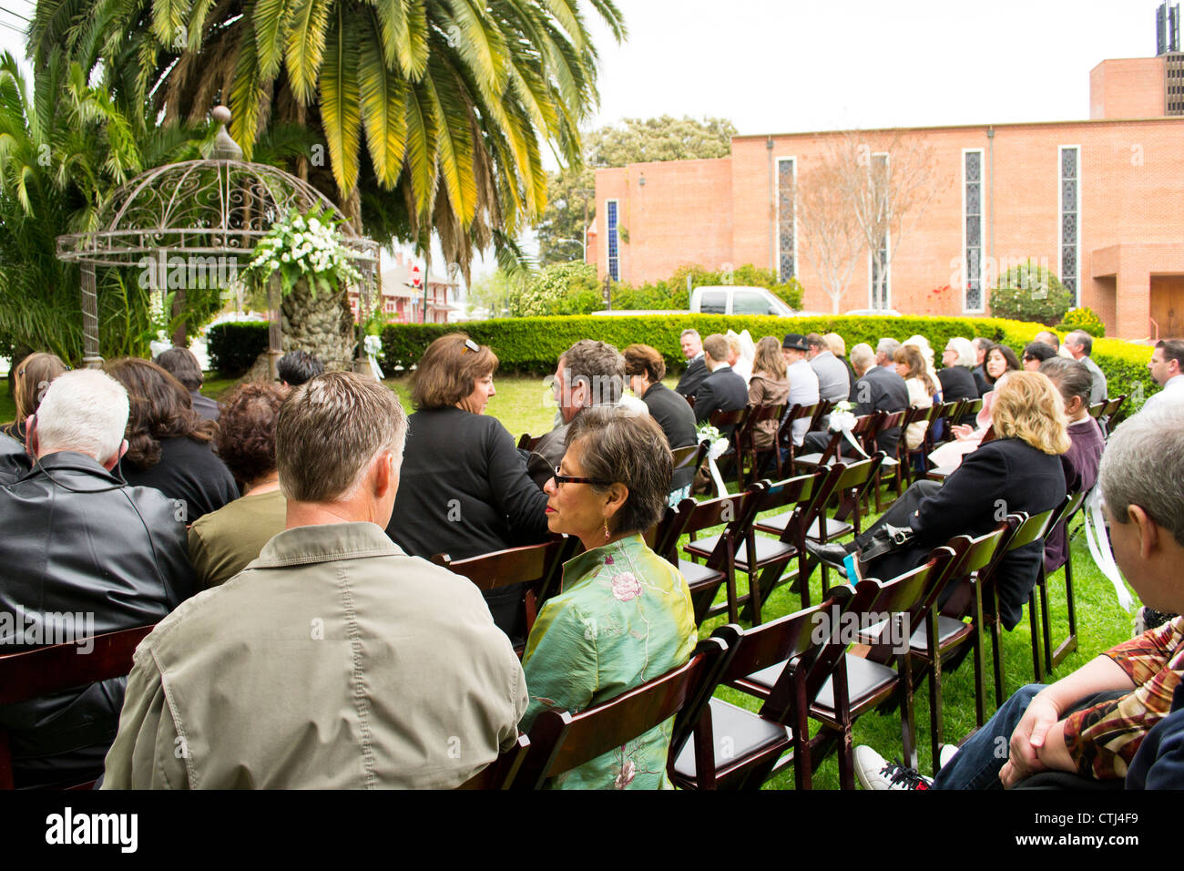 The audience waiting for the wedding to start. - Stock Image
