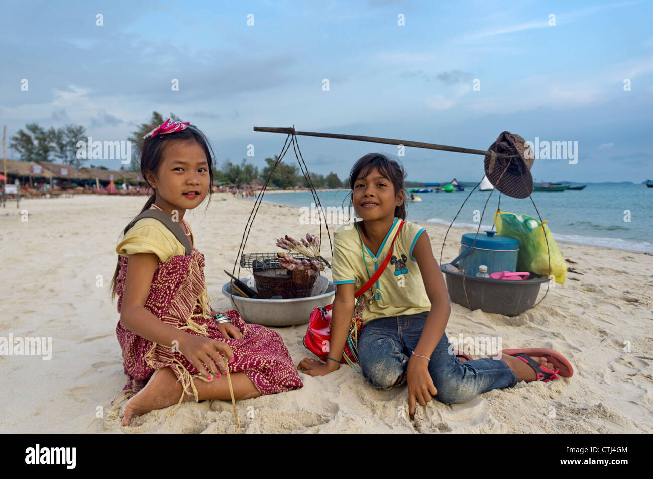 two girls selling food at Occheuteal Beach, Sihanoukville , Cambodia, Asia, - Stock Image