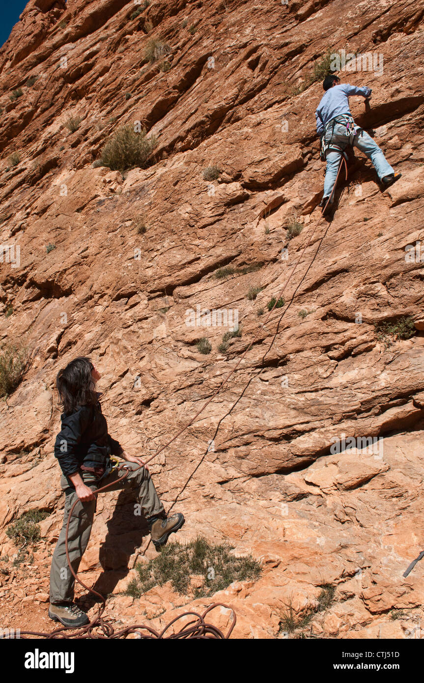 Rock climbers on a route in the Todra Gorge, Morocco - Stock Image