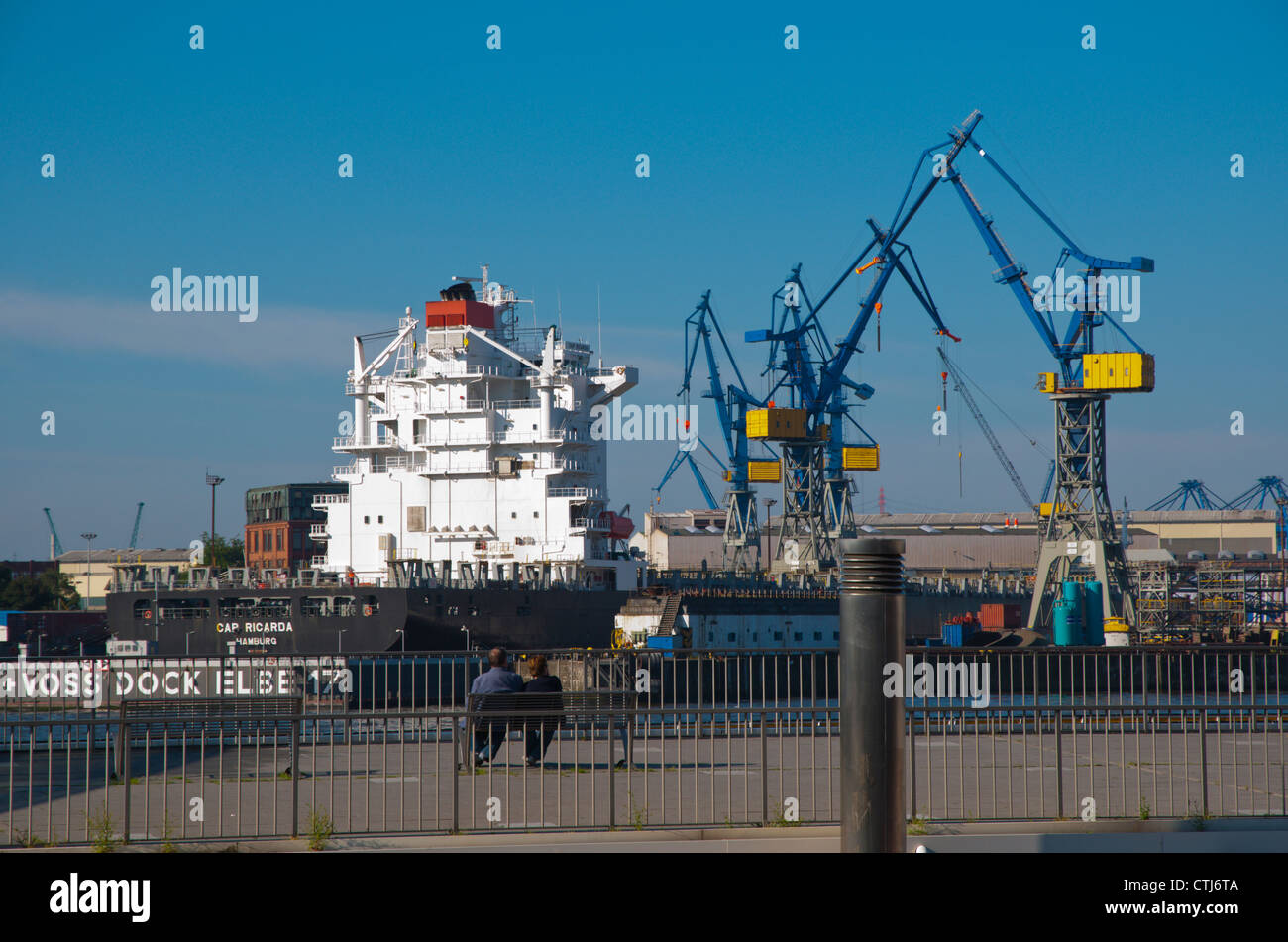 Harbour views towards Steinwerder docks from the shores of Sankt Pauli district Hamburg Germany Europe - Stock Image