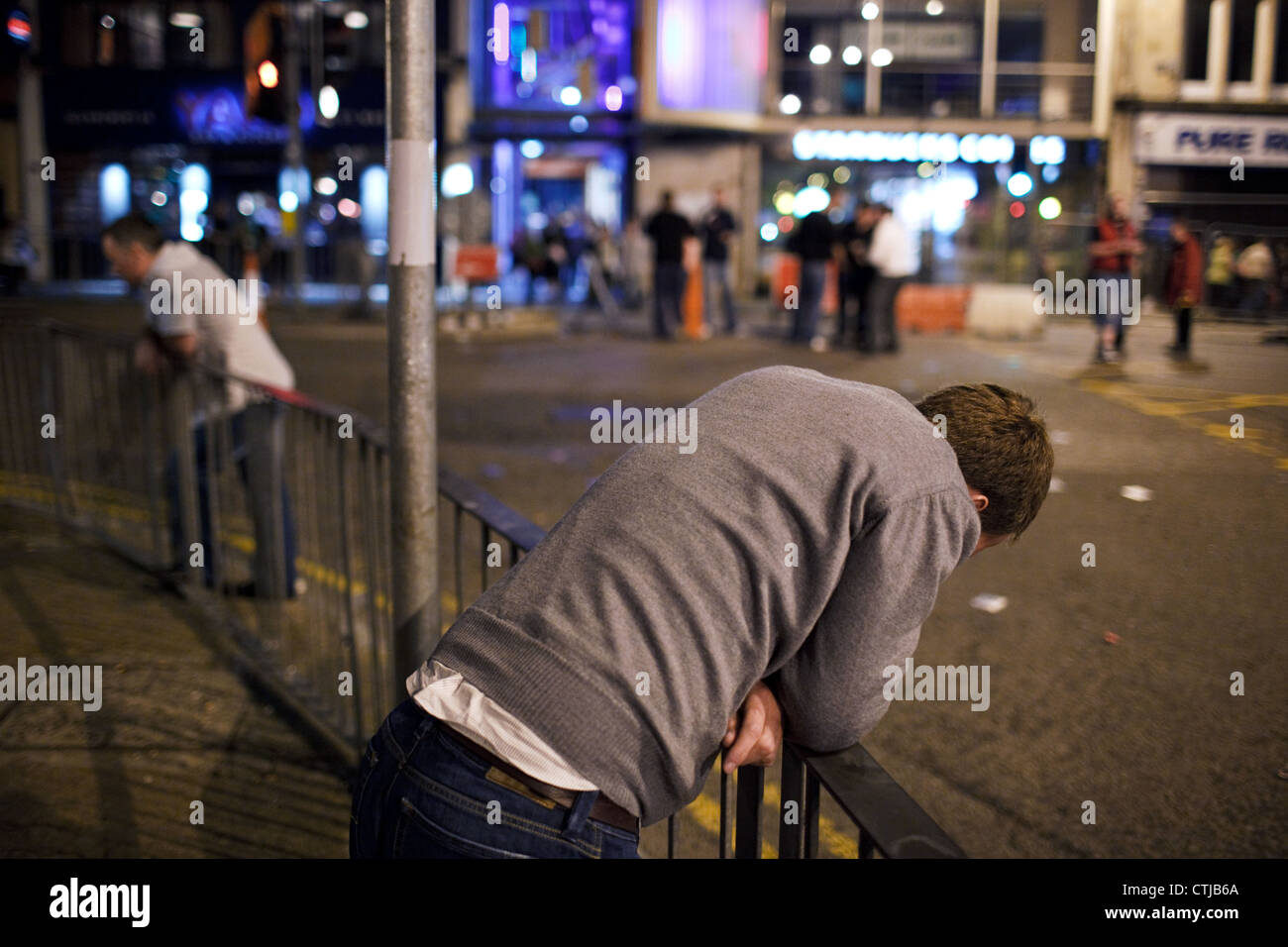 A young drunk man on a Saturday night in the city centre of Cardiff, Wales, Great Britain (UK). - Stock Image