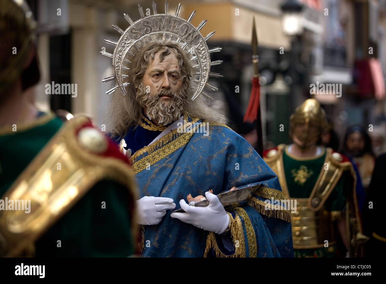 A man wearing a mask representing Saint Simon during an Easter Holy Week procession in Puente Genil, Cordoba, Andalusia, - Stock Image